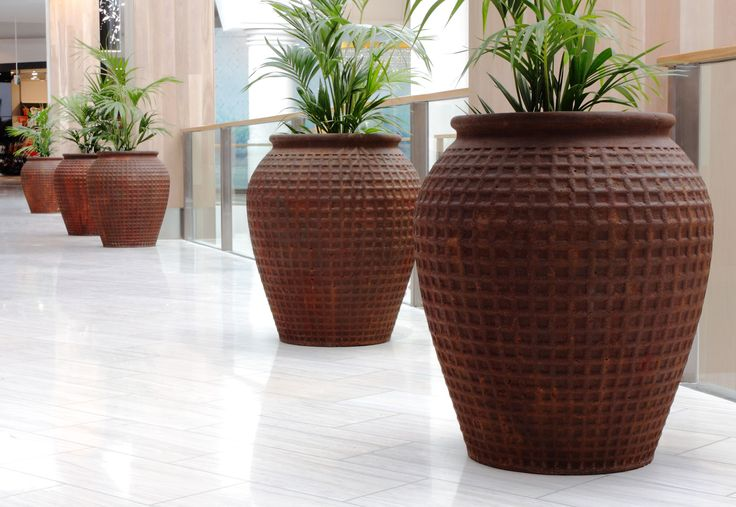 Our Rust Dimple Jar's look striking in both indoor and outdoor settings
