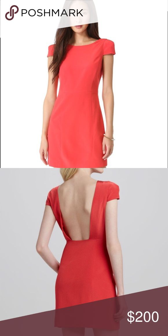 Tibi Dress Just gorgeous!! Tibi size 4 dress. It is a salmon color with a hidden zipper going down the side. The back is a drop style. The sleeves are capped, and are lightly padded. Perfect condition! worn once! Tibi Dresses Mini
