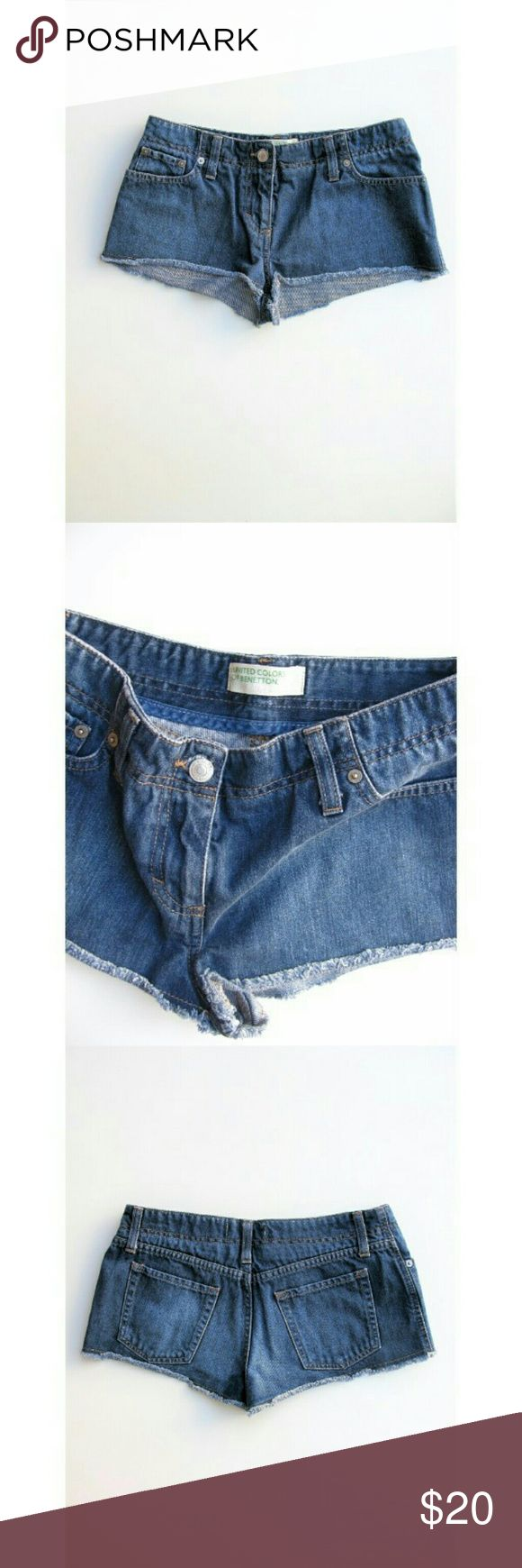 UCoB Cut-off Cheeky Jean Short Shorts 42/S United Colors of Benetton Cut-offs in Medium Blue Wash, 5 Pocket Styleing, Low Rise, Zip & Button, Frayed Hem - Excellent, Rarely Worn, Nearly New -  - Waist 14-- Hips 17.5-- Rise 8-- Length 8 outseam -- 100 Cotton United Colors Of Benetton Shorts Jean Shorts