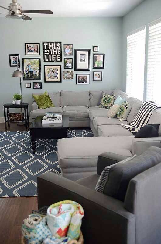 living room, family room, gallery wall, gray couch, oversized chair, blanket basket