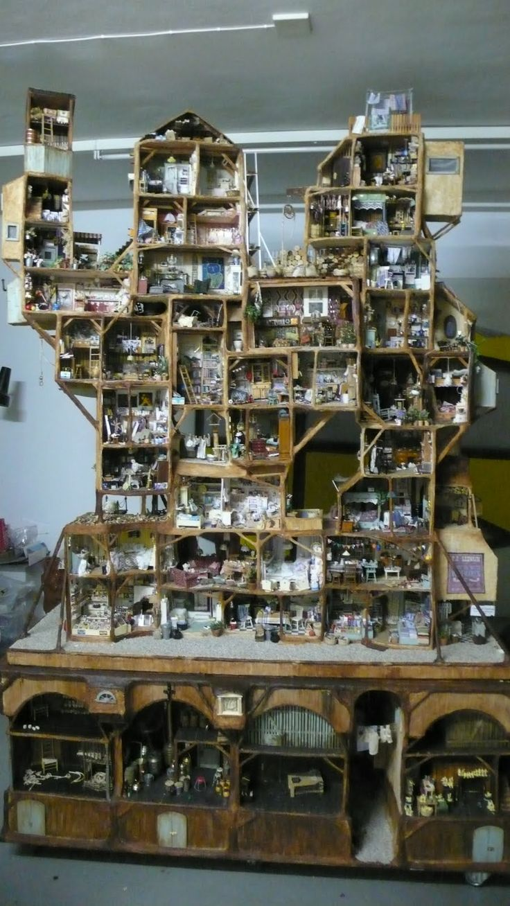 epic! > not just a dollhouse, a doll city.  This is for the 1/12 scale dolls, not my BJD size, but v. cool idea.