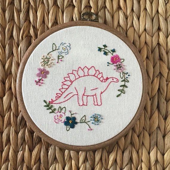 Hand embroidered dinosaur with flowers in a hoop with a hook ready to be hung in your home! 6 wide hoop as a frame and stitched on to a soft white coloured cotton. Copies may vary as they are stitched by hand and customised orders are welcome - just ask! Other colour combinations are also available, if you are wanting something in particular, send me a message and I will happily make you what you want :) Colours may vary to what you see on your monitor. Orders will take a week to make but…