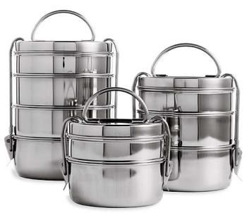 Tiffin Lunch Boxes - LOVE these! Tiffin lunch boxes consist of 3 to 4 containers stacked on top of each other.  A latch is then connected to hold all the containers together.  This latch comes with a handle at the top to make it easier to carry around.  The idea of using a Tiffin revolves around three concepts: simplicity, beauty, and function.