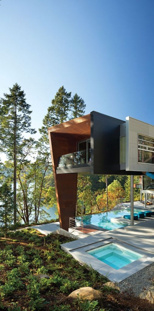 The infinity pool has a steel sculpture on the lee side of it (also designed by Robins) with holes that match the limestone pattern on the property (a replica of the plate he put in one of the windows. When a swimmer jumps in, water sluices through the holes. #prefab #house with beautiful #architecture! / TechNews24h.com