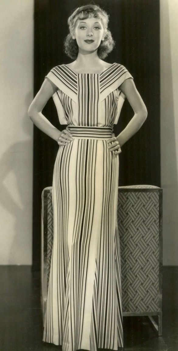 1934 striped evening dress gown early mid 30s era photo print ad column dress Egyptian influence white black glam