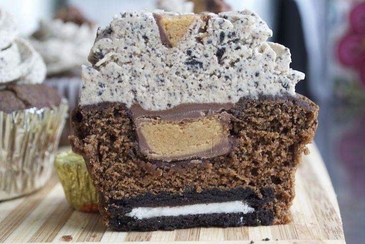 chocolate cupcake stuffed with an oreo and peanut butter cup, topped with oreo peanut butter buttercream