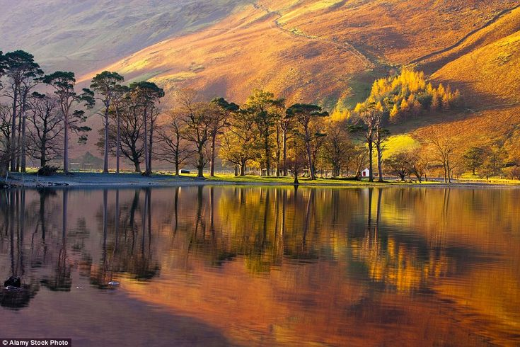 Seeing double: Take a walk by Lake Buttermere in Cumbria to see the dramatic foliage reflected in its waters