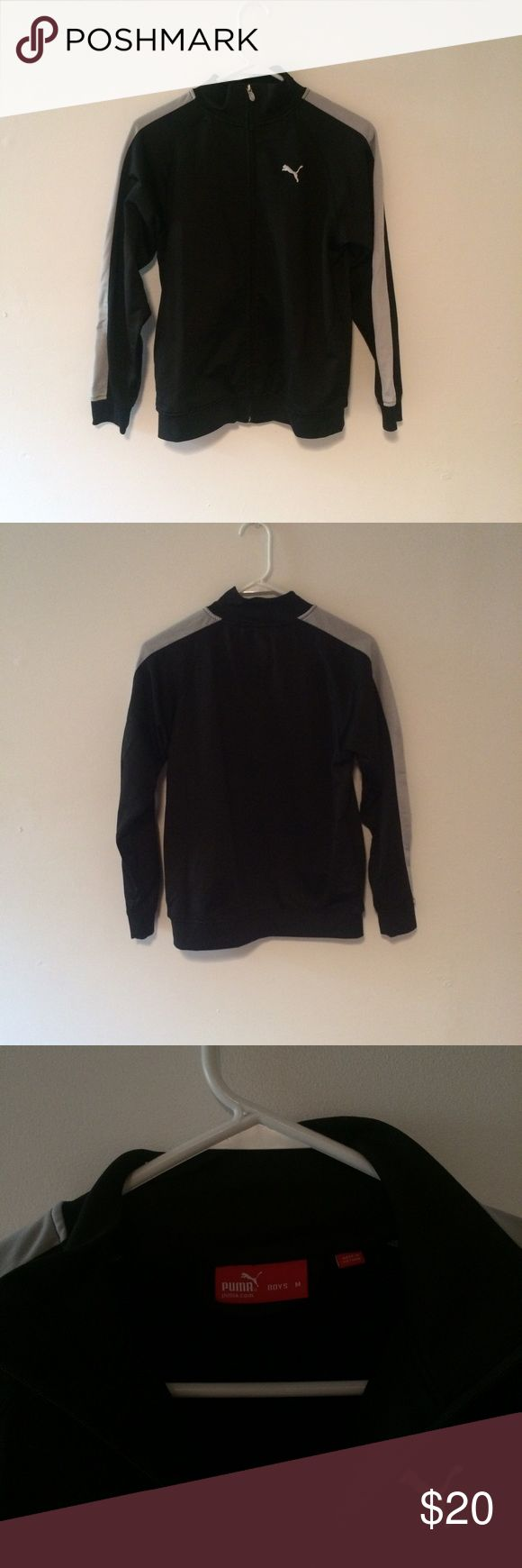 puma zip up it's a size medium in boys but fits a women's small. super cute puma zip up. black with silver on the arms. perfect condition Puma Jackets & Coats Performance Jackets