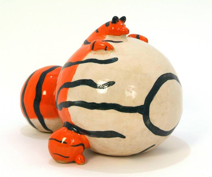 Ceramic fat tiger sculpture. Tigers are one of my favourite animals. Unlike most depictions of tigers my tiger is fat, friendly and approachable. This sculpture was exhibited in the Intuitive Folk exhibition in 2014.