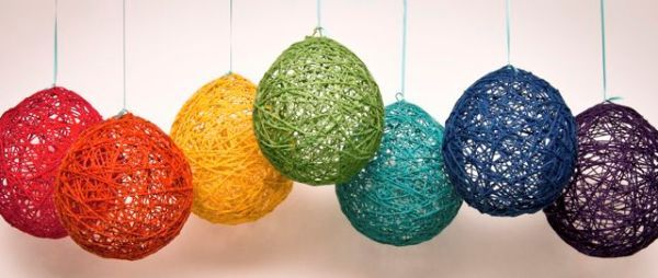 DIY yarn lanterns make great party decorations You'll need thin cotton yarn, balloons, craft glue, newspaper, wax paper, clothespins, and clothes hangers