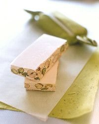 Torrone is a nougat confection typically made with honey, almonds, and egg whites, pressed into the shape of a stick and eaten at Christmastime. Besides its addition of pistachios, our updated torrone takes leave of tradition with dried cranberries and shredded coconut.