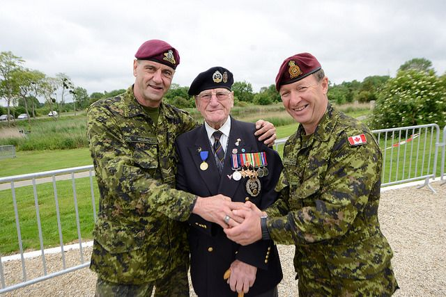 70th Anniversary of D-Day  Corporal Richard Mousseau and Warrant Officer Derek Lanteigne shake hands with military medal recipient, Veteran Fredrick Noone, of the Royal Hampshire 9th Commando Regiment during the 70th Anniversary of D-Day festivities on June 3, 2014.   Photo: Sgt Bern LeBlanc, Canadian Army Public Affairs