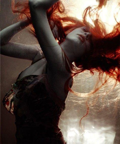 Female portrait (image from Nina Ricci's Premier Jour fragrance ad campaign).