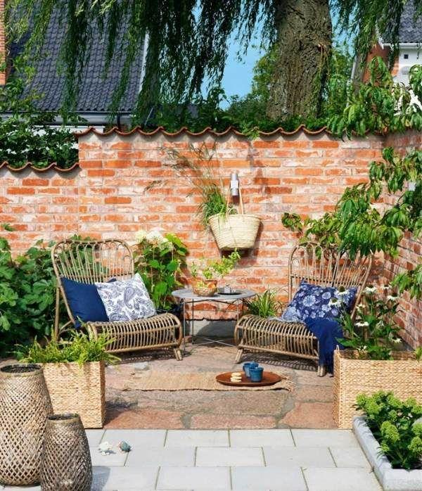 Garten Privatlebenziegelsteinzaun Rattanmobel Sichtschutz Rattan Mobel Garten Steinmauer Garten Vorgarten Ideen