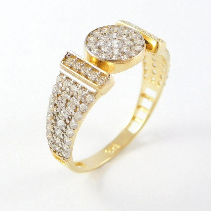 Sárga arany köves áttört gyűrű    Súly:1,9 g    Méret:54 (14)    Alkalmi viselet    Sárga arany gyűrű,a felület nagy részét kövekkel foglalták, a sín alsó fele áttört.