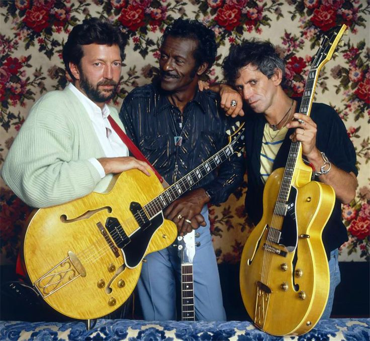 Guitarists Eric Clapton Chuck Berry and Keith Richards at Chuck Berry's Los Angeles home during the filming of Taylor Hackford's documentary 'Hail Hail Rock n Roll' 1986