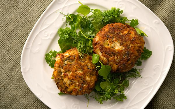 This is my homage to the North Country, where wild rice and pike, walleye and perch are king. These fish cakes are made with pike from Manitoba, but you could use any white fish. Mixed with mustard, herbs and wild rice, they are easy to make and wonderful to eat.