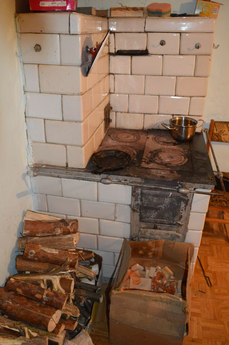 Inside the white lived in 19th century log house with Ukrainian style wood burner...