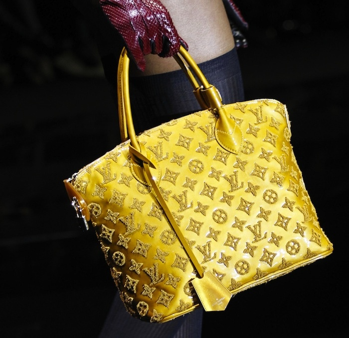 Louis Vuitton's bag of tricks collection was re-invented from the 1958 top handle Lockit bag. The glossy Monogram Vernis is embroidered with calfskin that adds texture and lots of definition to this bag! This bag is a pure Beauty!
