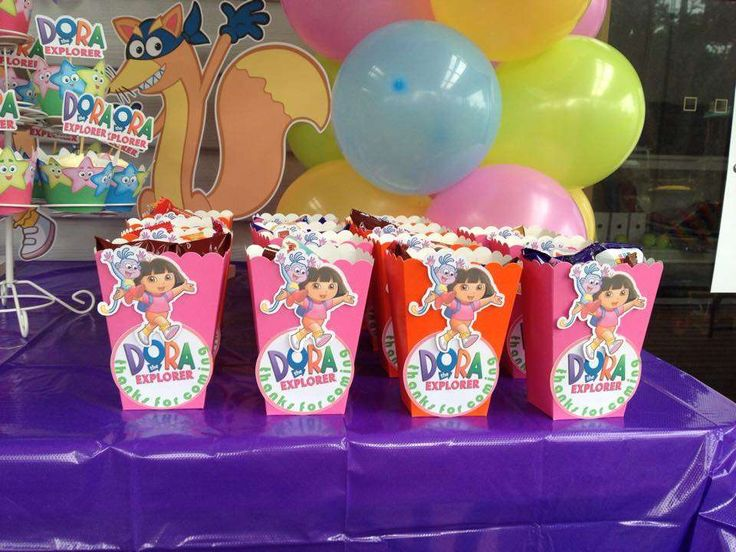 Favor boxes at a Dora the Explorer birthday party! See more party ideas at CatchMyParty.com!