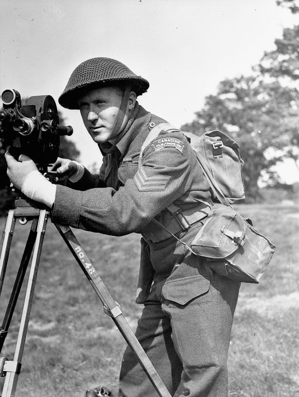 Sergeant Lew E. Weekes, Canadian Army Film and Photo Unit, England, 11 May 1944. May 11, 1944. Library and Archives Canada MIKAN 3586863