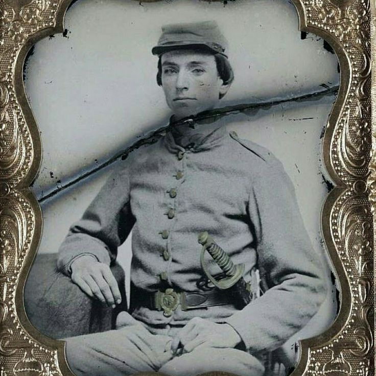 A young unknown Confederate soldier wearing a 2-piece sword belt plate.