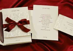 Ecru Fold-Over with Burgundy Ribbon Wedding Invitations by Birchcraft Studios. $163.90. Ecru Fold-Over with Burgundy Ribbon Wedding Invitations Wedding Invitations by Birchcraft Studios