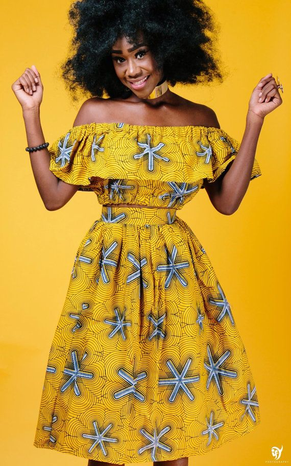African print midi skirt with 2 side pockets and zipper at the back. The skirt is fully lined *Crop top sold separately *  Made with 100% cotton high quality African print wax fabric and 100% cotton lining Skirt measures 30 inches long