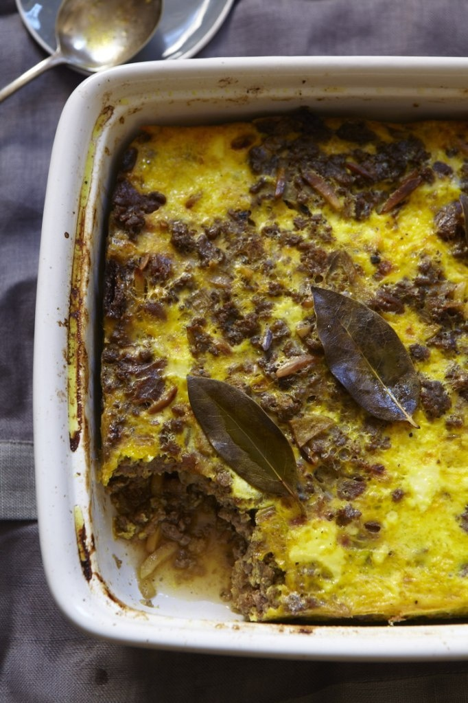 Babotie: a spicy, aromatic - not hot- dish made up of ground beef and peppered with roasted slivered almonds, dried apricots, sultana's, curry powder and turmeric, and topped with a sort of egg custard.