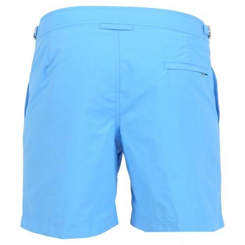 BULLDOG SKY BLUE NYLON MID-LENGTH BOARDSHORTS Bulldog sky blue nylon mid-length swim shorts with two front pockets and back zippered pocket. Side adjustable straps with metal buckle. Internal net. Snap button and zipper closure. COMPOSITION: 100% POLYAMIDE. Internal net: 100% POLYESTER. Model wears size 32 he is 189 cm tall and weighs 86 Kg.