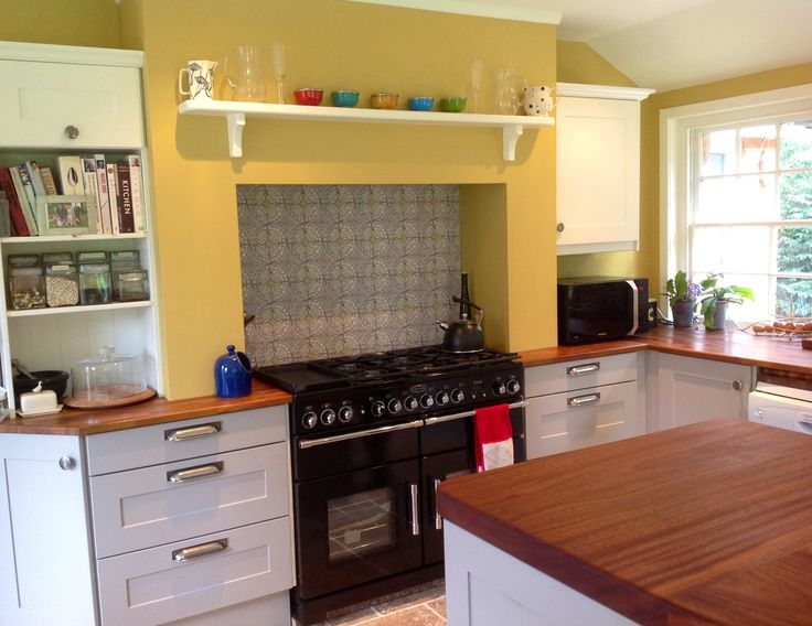 Grey and yellow kitchen. Farrow  Ball Sudbury Yellow, Dovetail Grey and Pointing. Tiles by Louise Body.