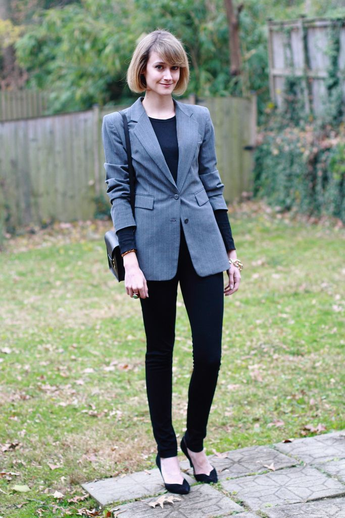 E of District of Chic wearing a pinstriped blazer and black skinny pants to work