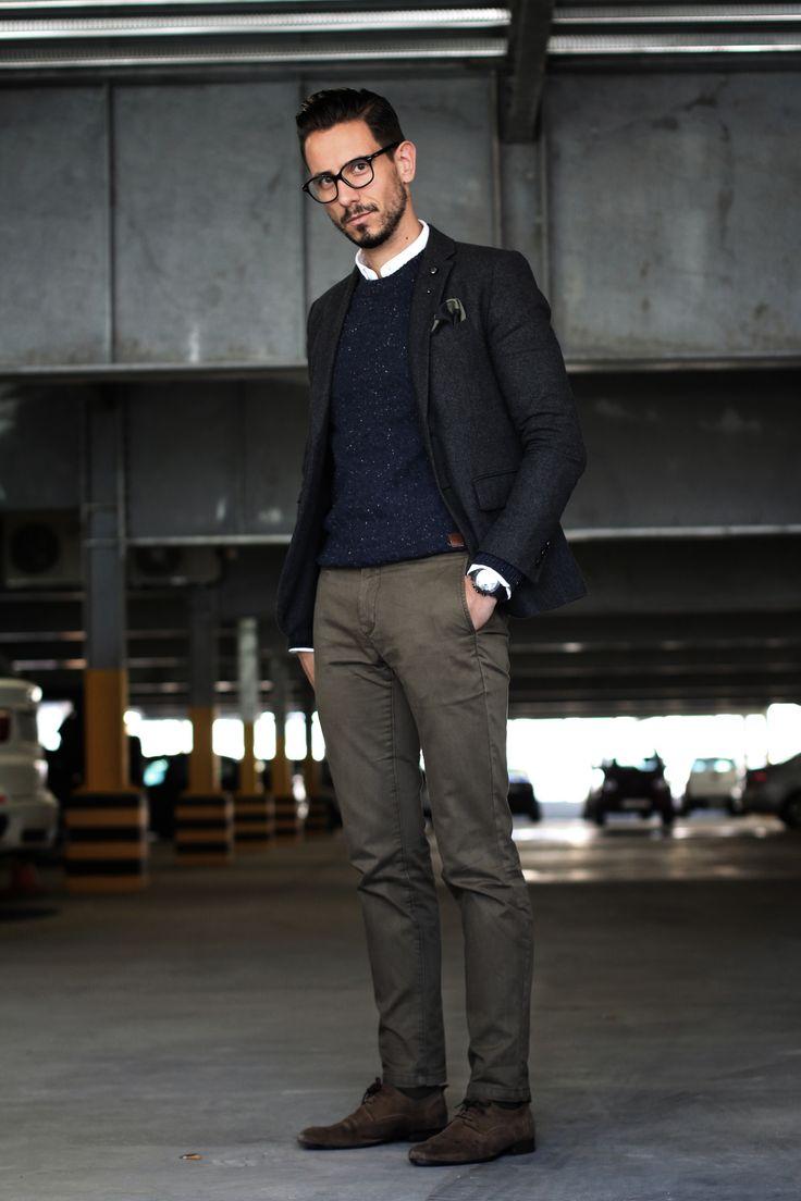 White oxford shirt, Textured navy sweater, grey blazer, skull lapel pin, camo pocket square, khaki slim chinos, brown suede shoes