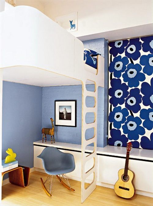 Cute loft bed for kids - nice and high so room still feels open. The duck egg blue wall provides a fresh contrast.