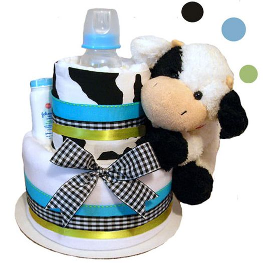 It�s so Cow-dorable! And the perfect way to welcome a new baby boy! The Cow Print Blue diaper cake is a clever and useful gift for the soon to be new mom. Featuring a darling cow print design, this charming centerpiece coordinates with the Baby Cow Print party theme. The 2- tier diaper cake is constructed of disposable diapers, a cow print burp cloth, a baby blanket, a baby care item and a cuddly cow plush pal. Accented with coordinating ribbon, diaper cake makes a great conversation piece…