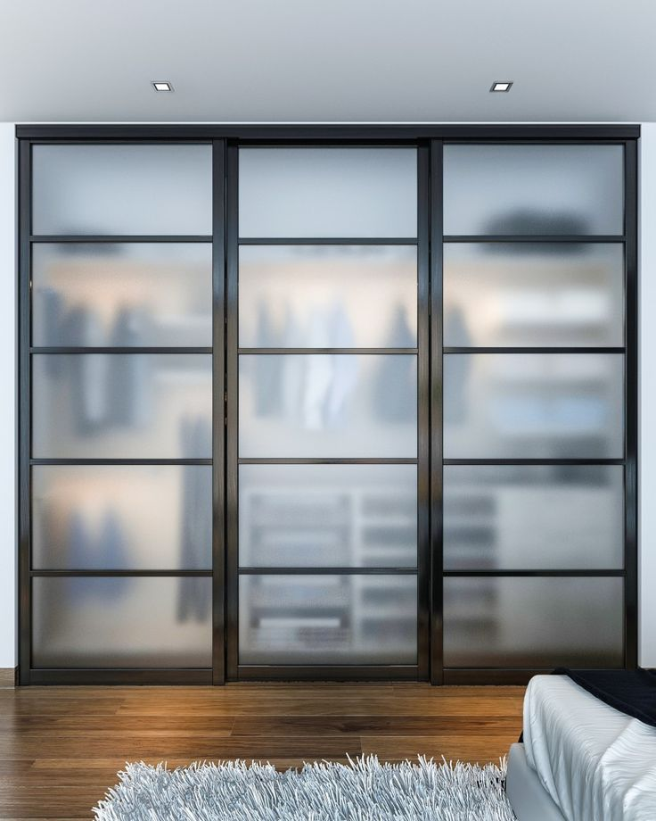 This reach-in closet showcases beautiful closet doors that sit on triple tracks. The frosted glass panels create a modern look with a hint of transparency. #closetfactory Learn more: http://www.closetfactory.com/custom-closets/