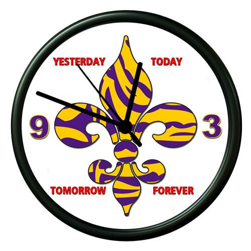 "Fleur delis Personalized Clock with purple and gold Fleur delis can be customized with you own slogans. This Fleur delis wall clock is 14"" and uses one AA battery (not included), just insert a battery, set the time and your wall clock is ready to hang right out of the box."