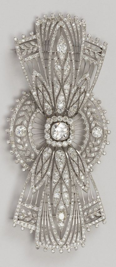 Boucheron - An Art Deco platinum and diamond bow brooch, circa 1920. #Boucheron #ArtDeco