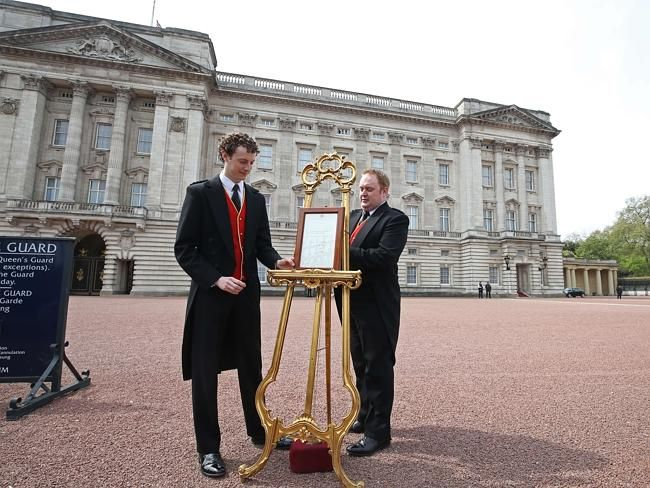 """Tradition ... The easel in the forecourt of Buckingham Palace in London to announce the birth of the new Princess. The easel, the same one used for the announcement of Prince George's birth in July 2013, was carried by two footmen — ultimate """"accidental heroes"""" who solely by virtue of the Palace roster now have something to tell their grandkids. The third and final announcement from Kensington Palace regarding the birth (the first was a tweet that Princess Kate was in labour) is expected…"""