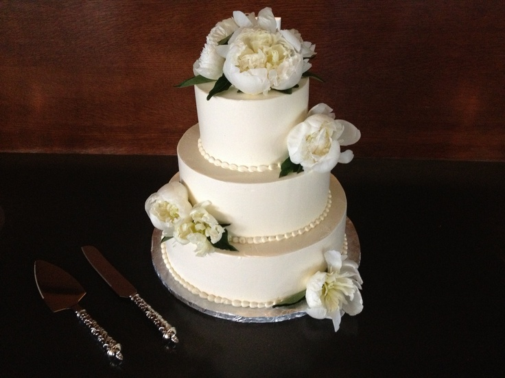 Small wedding cake with flowers beautiful. With mobile sound entertainment.
