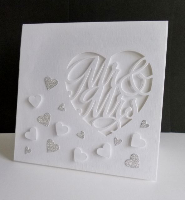 I was a bit stumped with the sketch until I thought 'wedding' … I die-cut the big heart on the panel and popped it up with foam tape and tiny pads behind the letters. The white punched hearts are popped up on a tiny foam pads too.