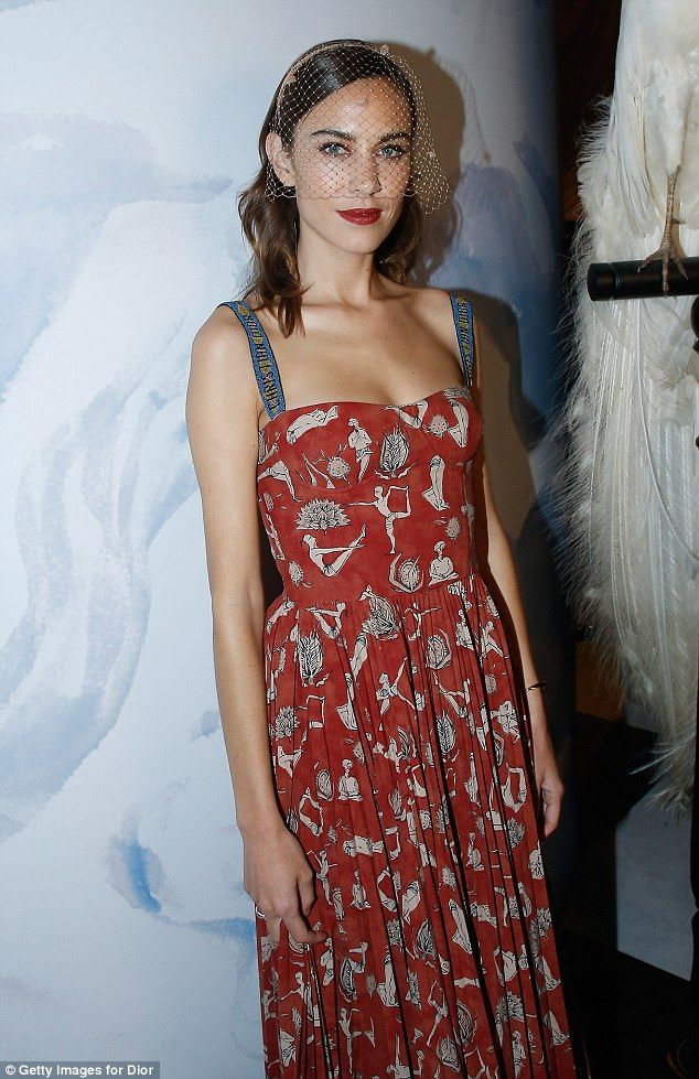 Vintage vibes: Alexa Chung was her usual quirky self in a terracotta tea dress and headdress as she posed at the event