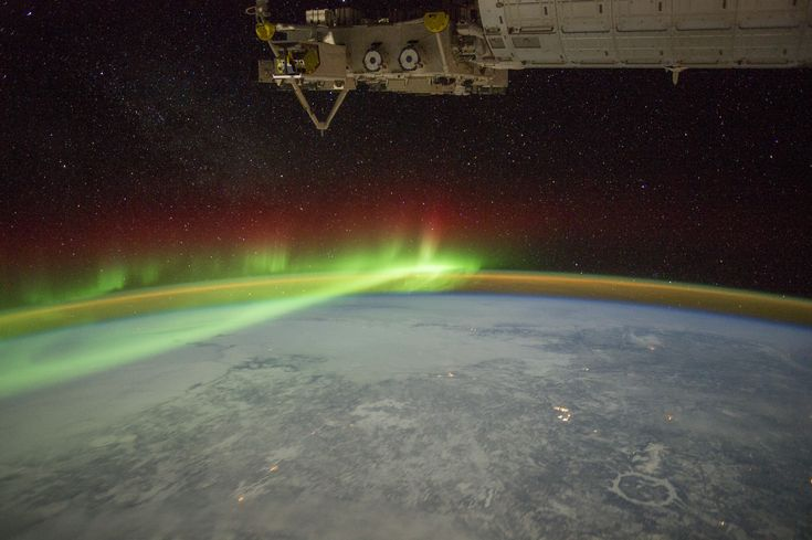 Aurora and Manicouagan Crater: An astronaut aboard the International Space Station adjusted the camera for night imaging and captured the green veils and curtains of an aurora that spanned thousands of kilometers over Quebec Canada.