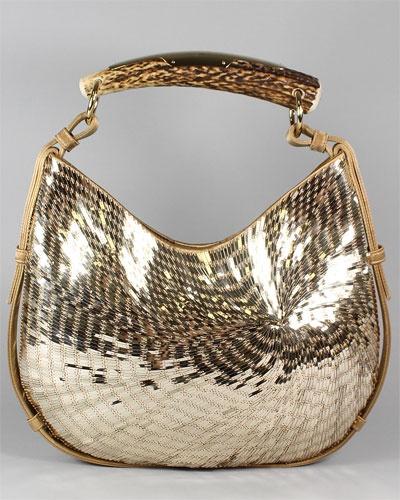 Some serious bling on handbag happening..............I like it ...