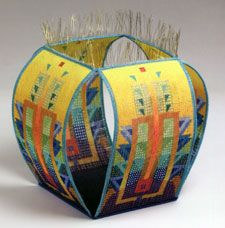 Loom Woven with wire and seed beads by Jeanette Ahlgren.