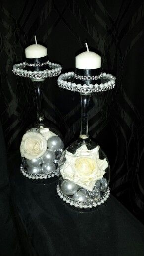 Great idea! I got large wine glasses from the dollar store for $1 each and using what I had accumulated over the years from baby and bridal showers to weddings and birthday parties, I created these gorgeous candle stands for next to nothing. Such a good idea and so cute to use anywhere as decoration on the dresser or living room coffee table, etc.