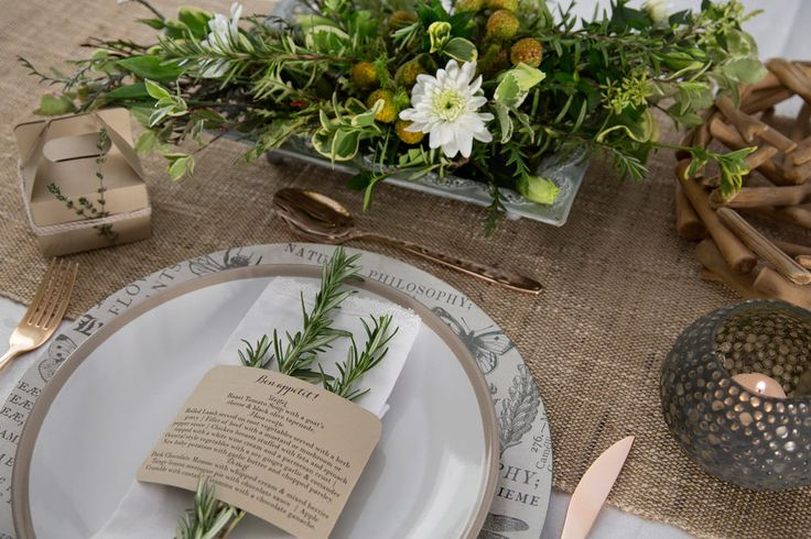 Rustic wedding table setting. Wood and herbs. Kraft paper wedding menu and favour boxes with thyme and rosemary. Styling by Jani Venter. Photo by Rikki Hibbert. Flowers by Diamonds & Pearls Event Styling.
