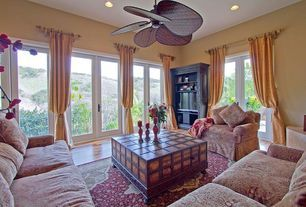"Mediterranean Living Room with French doors, Ceiling fan, Fanimation 52"" Islander 5 Bamboo Blade Ceiling Fan, Laminate floors"
