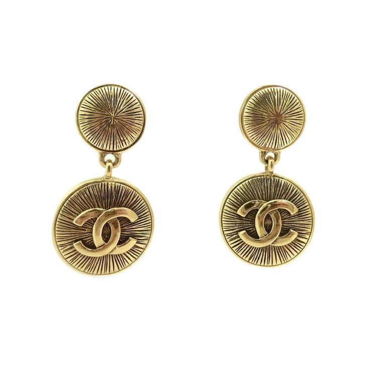 Vintage Signed Chanel Logo Earrings | From a unique collection of vintage clip-on earrings at http://www.1stdibs.com/jewelry/earrings/clip-on-earrings/