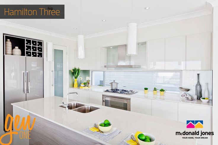 A sleek, modern kitchen with splashes of colour creates the ideal space for the head chef of the family, don't you think? This Gourmet Kitchen is from our Hamilton Three on display in Northalkes, QLD. For details on this design visit http://mcdonaldjoneshomes.com.au/home-designs/new-south-wales-and-queensland/hamilton. #kitchen #headchef #cooking #pendantlights #splashback #islandbench #counter #gourmetkitchen #kitchendesign #kitchendecor